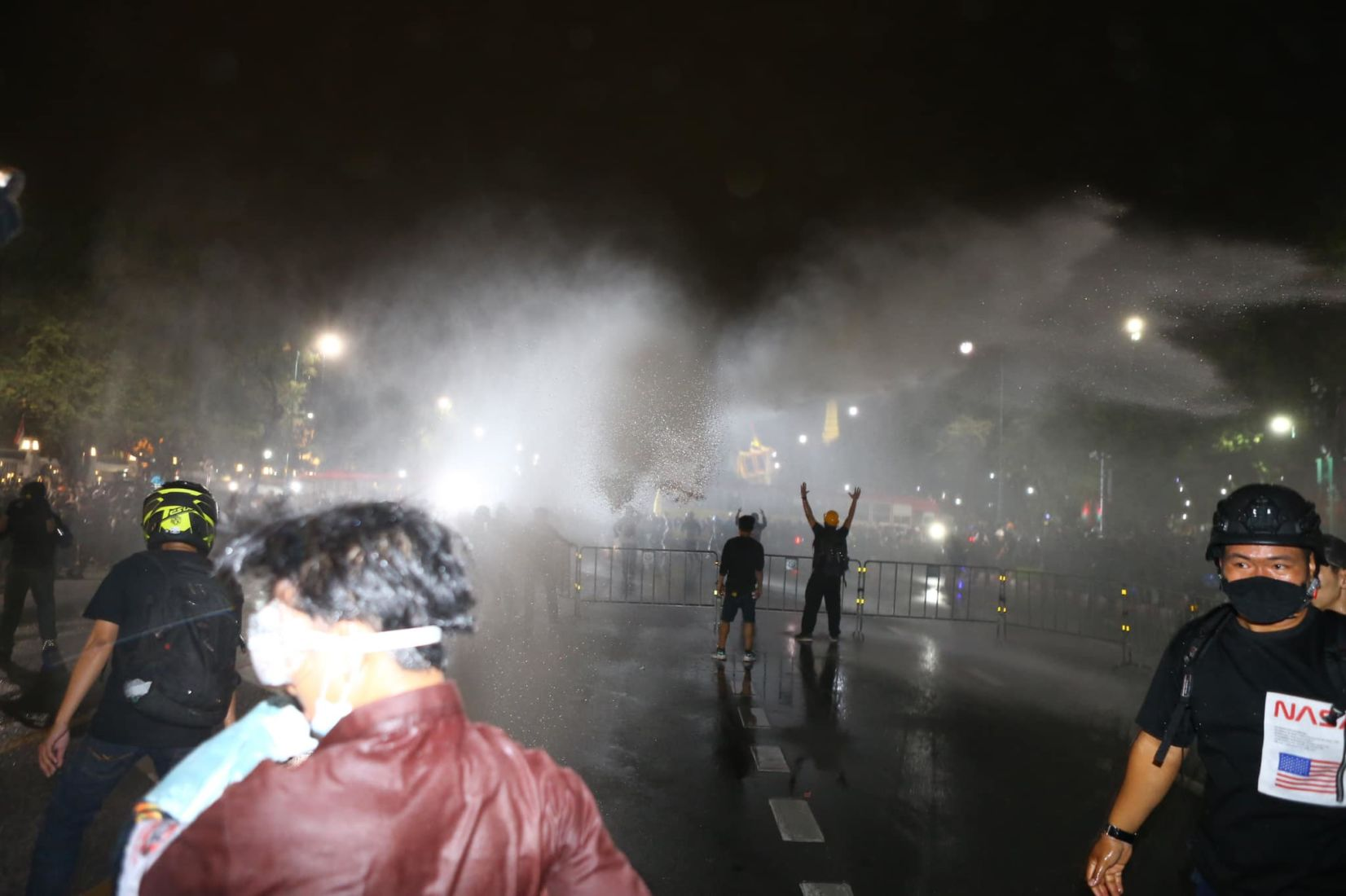 3 protesters injured as police turn on the water cannons again at last night's protest | News by Thaiger