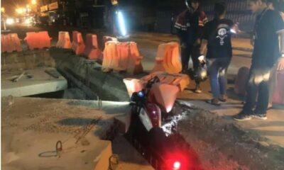 Good samaritans help motorbike stuck in Pattaya construction pit   The Thaiger