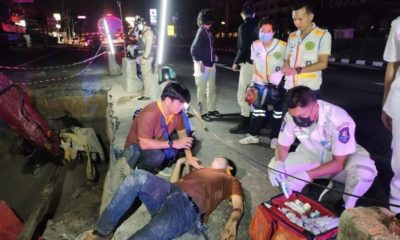 Pattaya bike rider injured after plunging into large construction hole in road | Thaiger