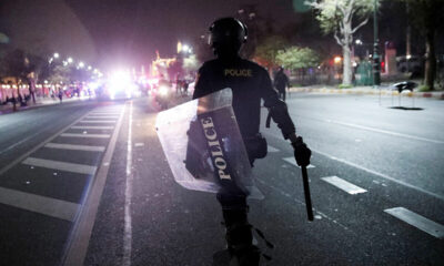 Thais speak out against police violence after riot officers beat volunteer medic | The Thaiger