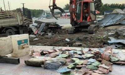 Backhoe driver digs up 100,000 baht in cash buried in Nakhon Si Thammarat | Thaiger
